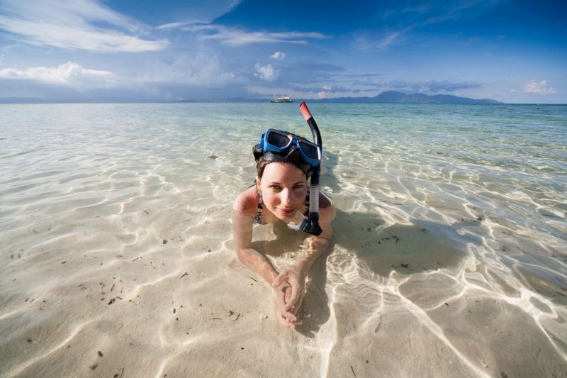 A tourist woman snorkeling in Palawan
