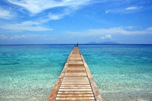 A long boardwalk and turquoise sea in Langah Tengah Island