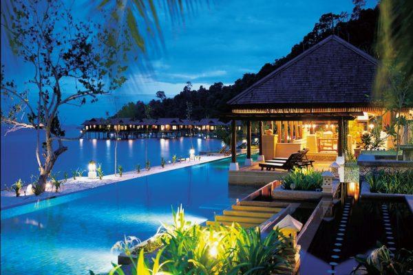 Swimming pool area at night at Pangkor Laut Resort
