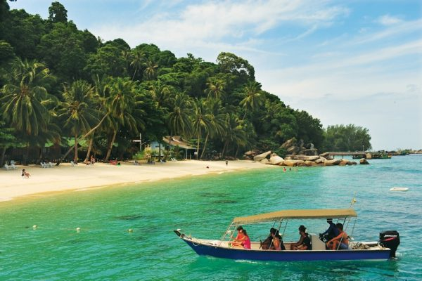 A boat with tourists approaching Perhentian Besar Island