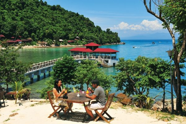 Tourists having lunch on the beach in Perhentian