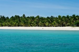Picture perfect beach with white sand, turquoise ocean water in Bantayn Island