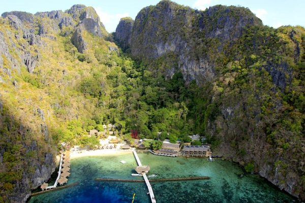 Aerial view of Miniloc's El Nido Resorts nestled between the limestone cliffs