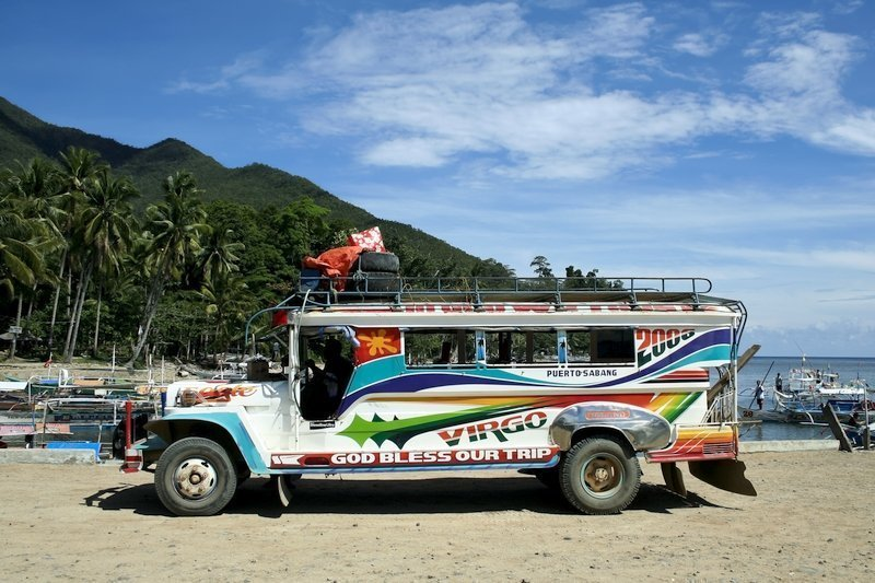 A Colourful Jeepney on the beach in Palawan