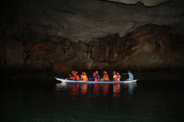 A group of tourist on a canoe exploring Puerto Princesa's Underground River