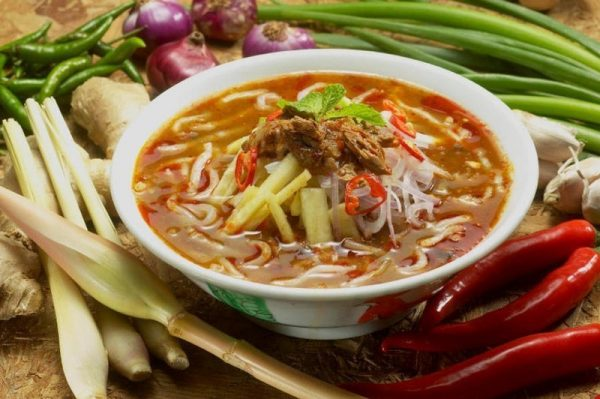 A bowl of Penang Laksa Soup