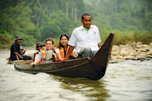 Tourists on a longboat in the rainforest of Malaysia's Taman Negara National Park