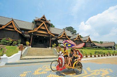 Tourists exploring Malacca on a trishaw