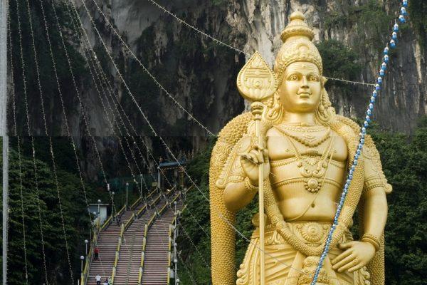 The golden statue of Lord Muruga outside the Batu Cave Hindu Temple