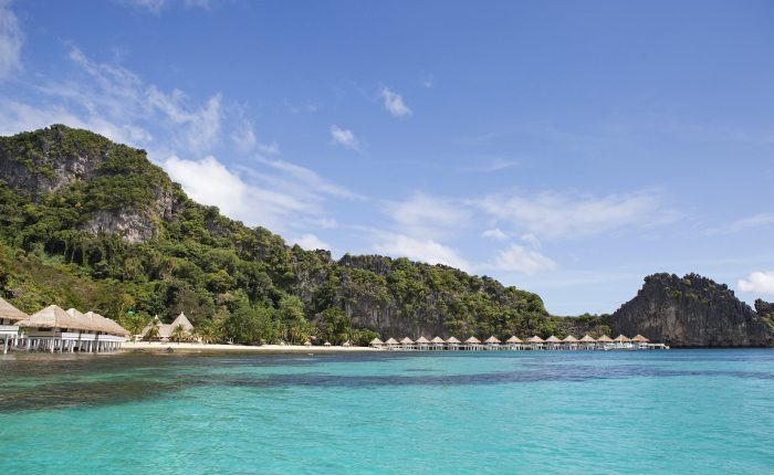 Apulit island resorts nestled between the limestone cliff and crystal clear turquoise sea