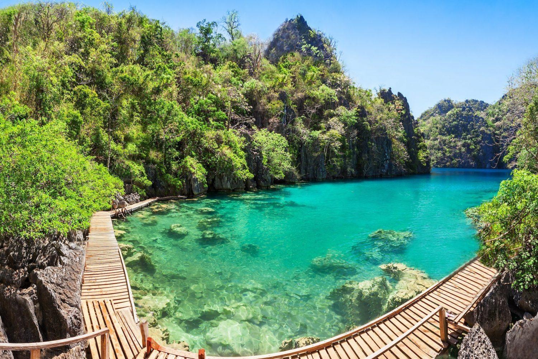 Panoramic view of the crystal-clear waters of Lake Kayangan in Coron Island