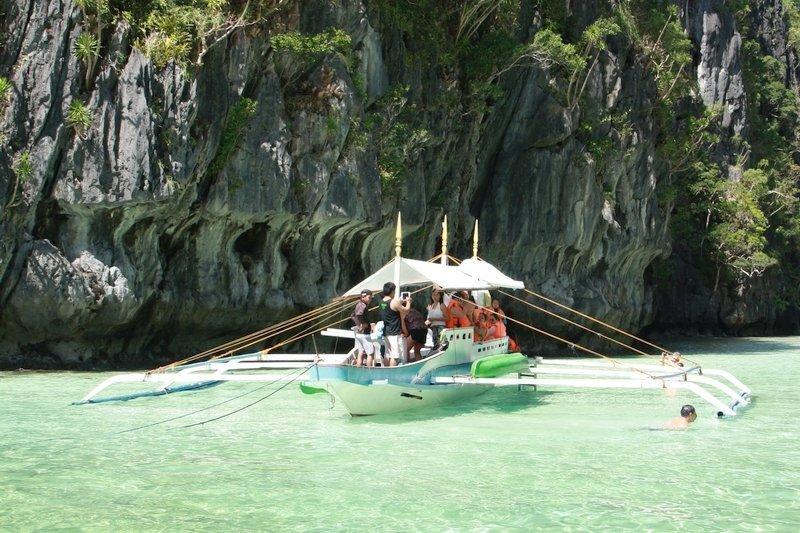 Tourist boat exploring El Nido's Big Lagoon
