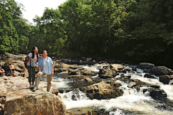 A couple of tourists enjoying Taman Negara's Lata Berkoh