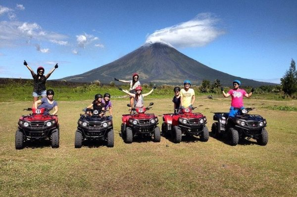 A group of tourists exploring Mayon Volcano on ATV
