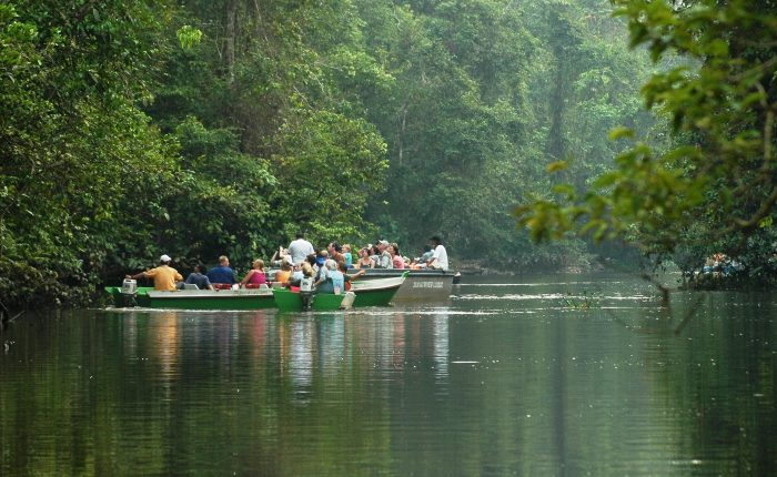 Tourists exploring Menanggol River in search of wildlife