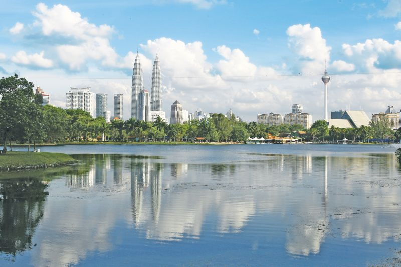 Lake and park overlooking Kuala Lumpur City Centre and Petronas Twin Towers