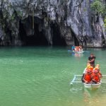 Tourists exploring the Underground River on a day trip from Puerto Princesa