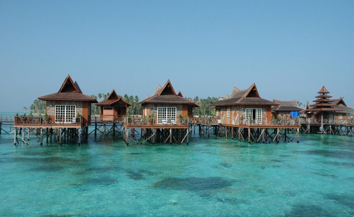 Bungalow over-the-water at Mabul Water Bungalow Resort overlooking the blue lagoon