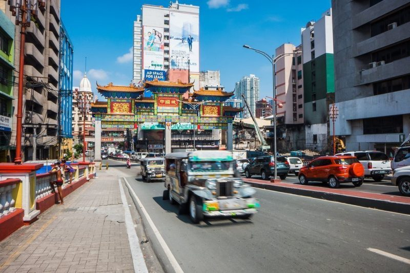 A jeepney driving through the streets in Manila