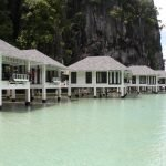 Bungalows over-the-water overlooking the lagoon in front of Lagen Island's El Nido Resorts