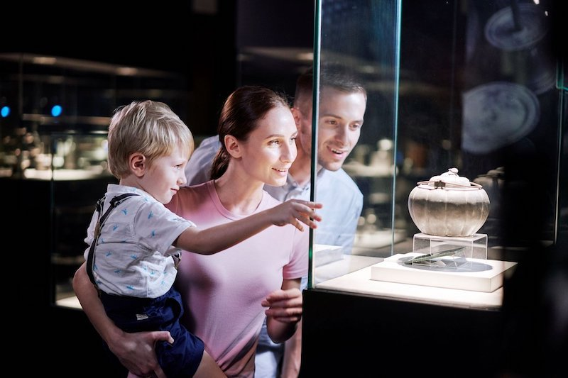 A family visiting the Royal Selangor Visitor Centre to see how pewter is made