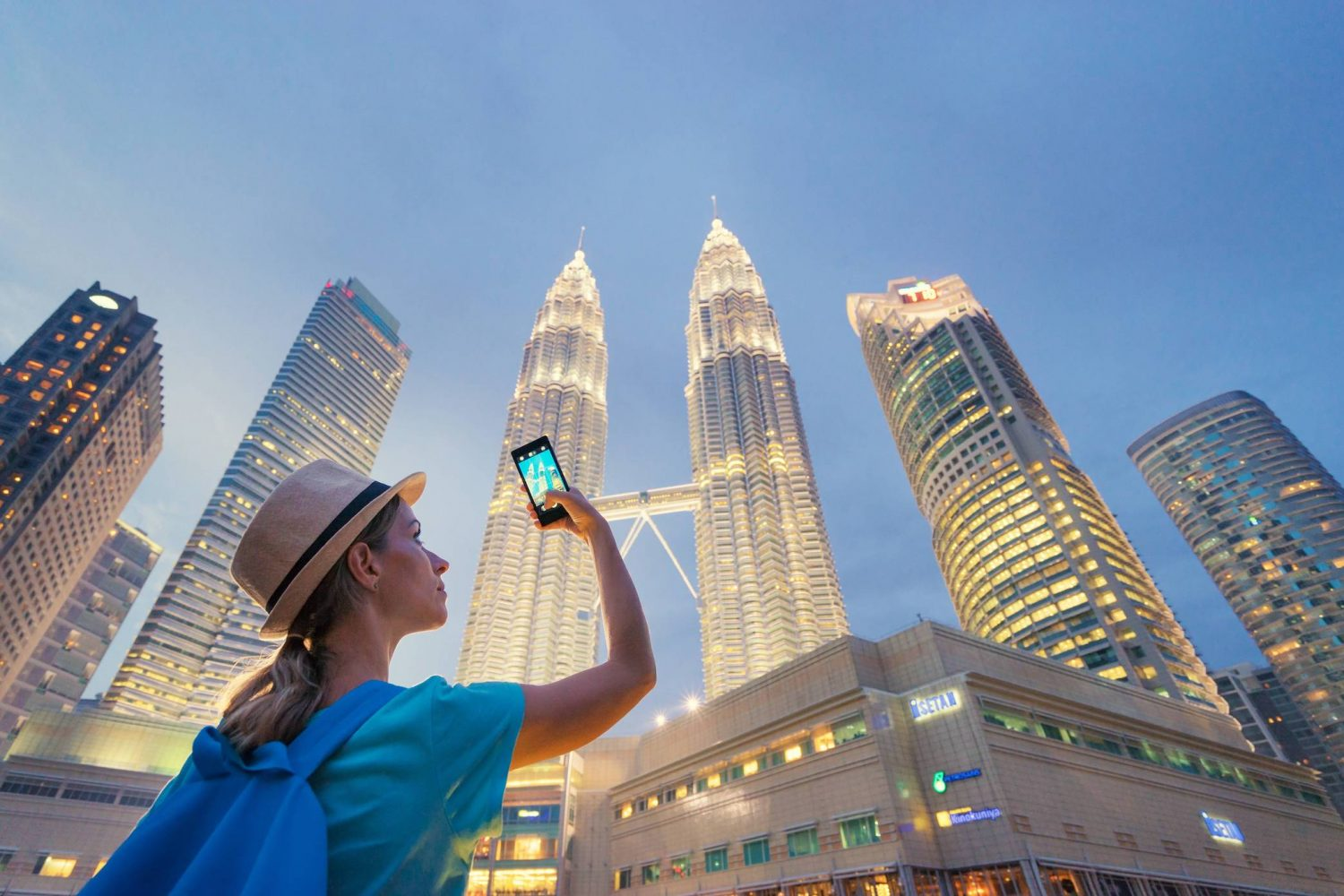 Tourist taking a photo of the Petronas Twin Towers