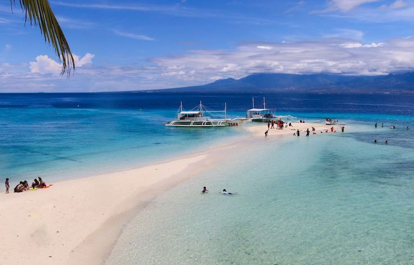 White sandbar and crystal clear water in Sumilon Island