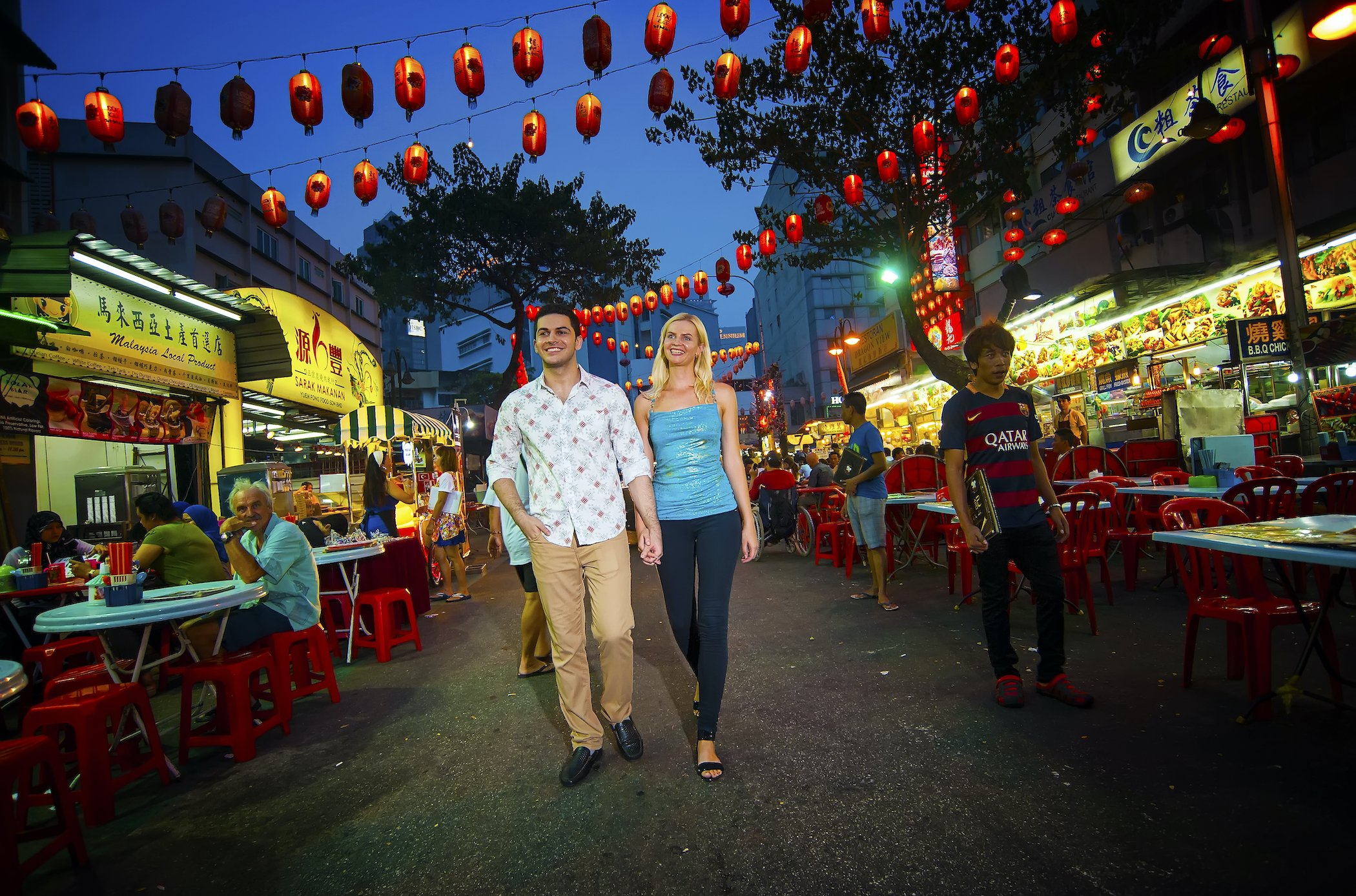 Tourists walking among the hawker stalls in Kuala Lumpur