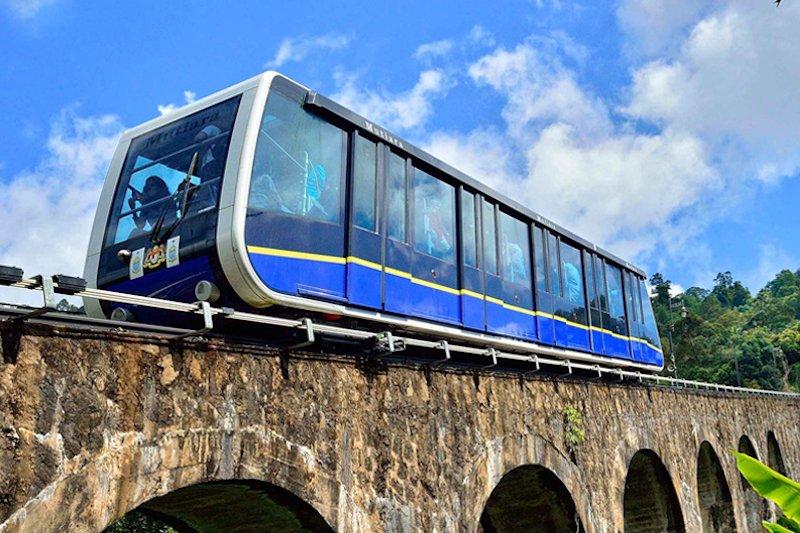 Tourists riding Penang Hill funicular train