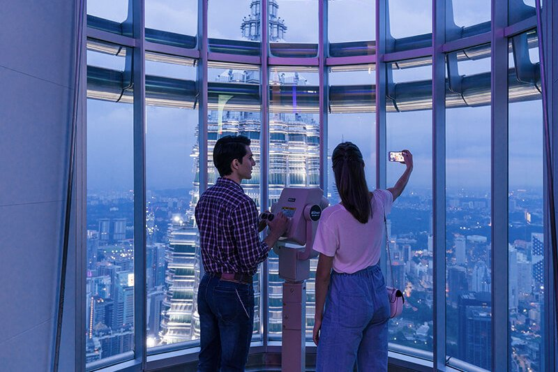 Tourists enjoying the view from Petronas Twin Towers' Observation Deck